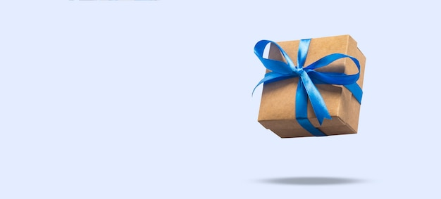 Flying gift box on a light blue surface. holiday concept, gift, sale, wedding and birthday. .