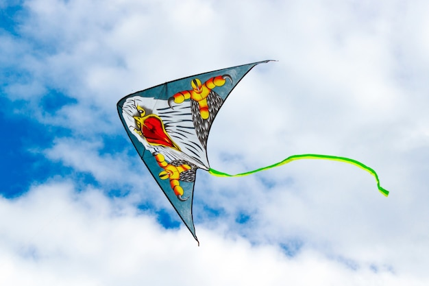 Flying kite on a blue sky background