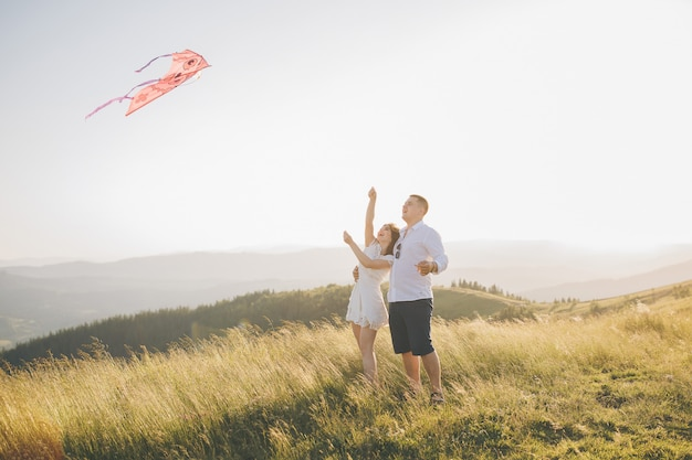 Flying kite in hand. sunny spring day. flying kite have fun on countryside.