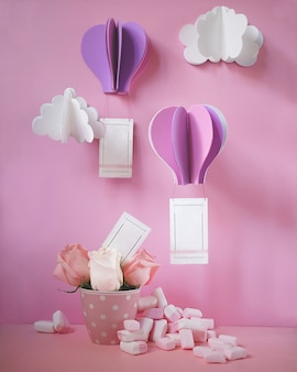 Flying paper cut balloons with rectangle frames.