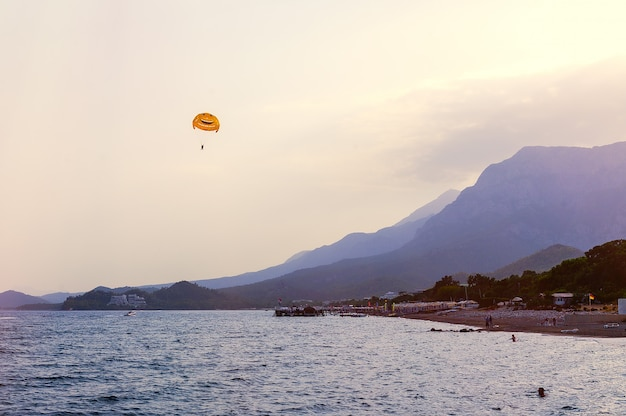 Flying parachute over the sea near the mountains of turkey
