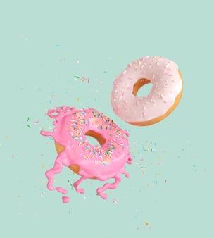 飛んでピンクと白のドーナツを振りかける