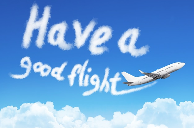 Flying a plane in the sky with the inscription - have a good flight.