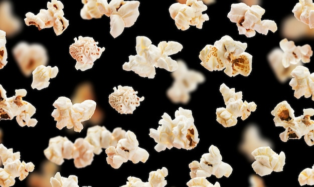 Flying popcorn on black