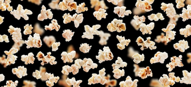 Flying popcorn isolated on black