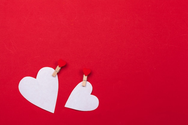 Flying red paper hearts background