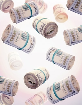 Flying rolls of one hundred dollar bills. abstract money background