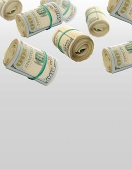Flying rolls one hundred dollar bills