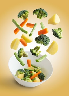 Flying vegetables on bowl