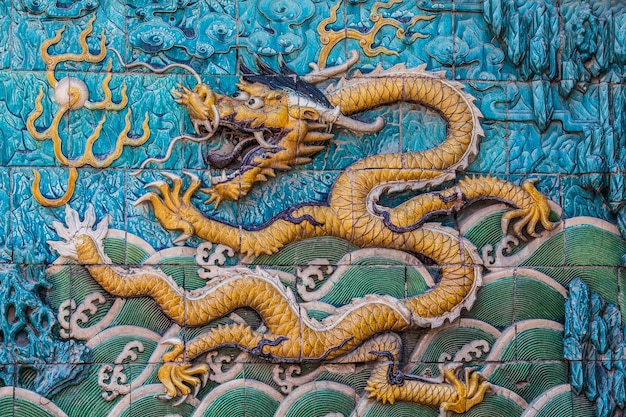Flying yellow imperial dragon on the wall