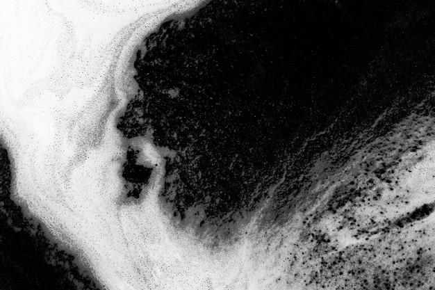 Foam on black liquid abstract