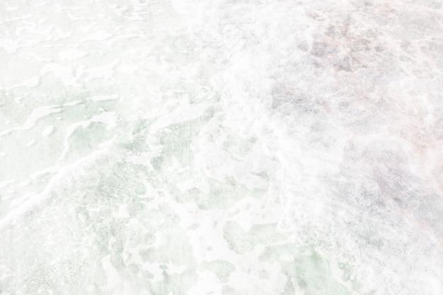 Foam on the ocean textured backdrop