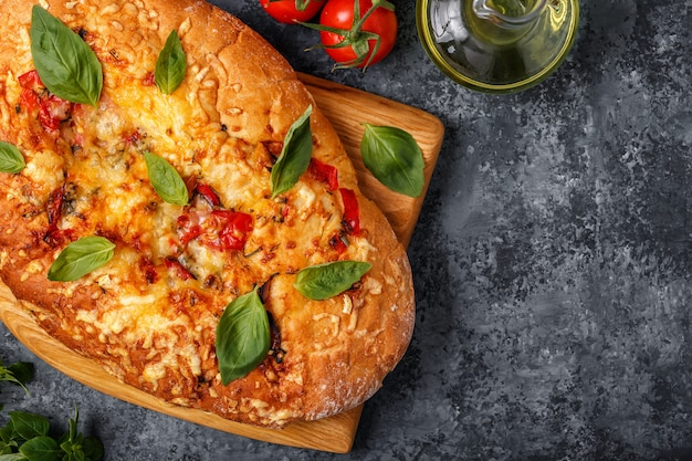 Focaccia with tomatoes, herbs and cheese.