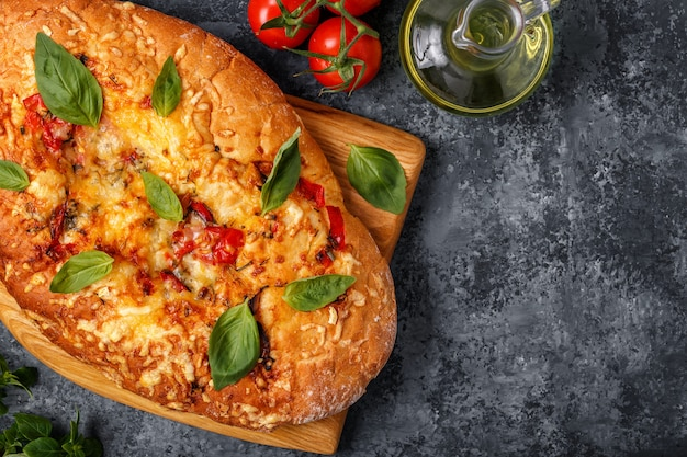 Focaccia with tomatoes and herbs