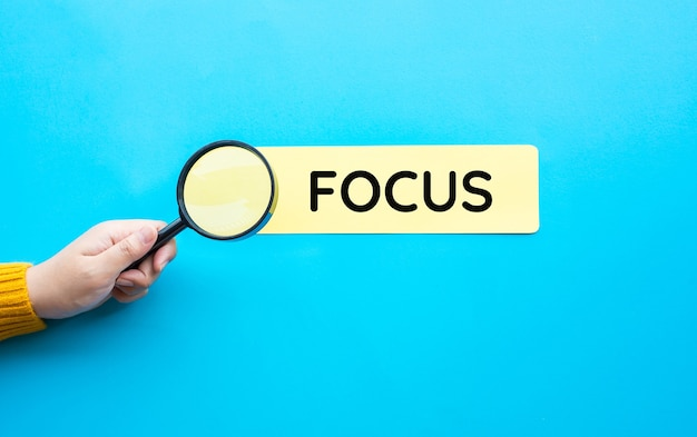 Focus and analysis concepts with person hand and magnifying.education or learn
