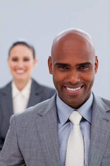 Focus on an attractive businessman smiling