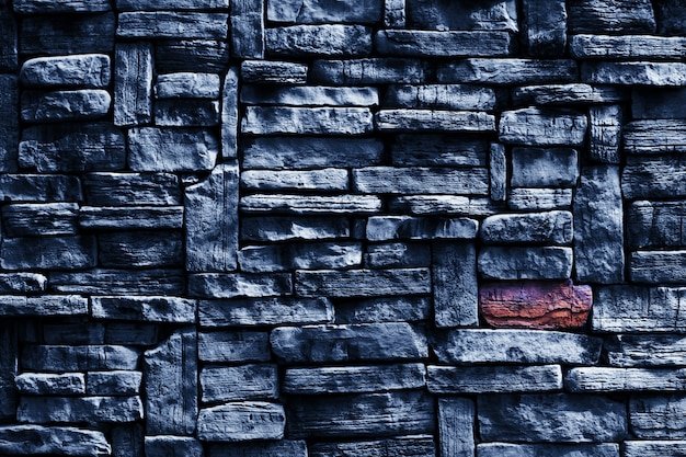 Focus to hard granite wall ancient stone exterior texture surface with gray background