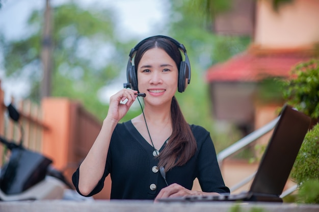 Focus microphone asian women working from home call center service consult support, business work new normal