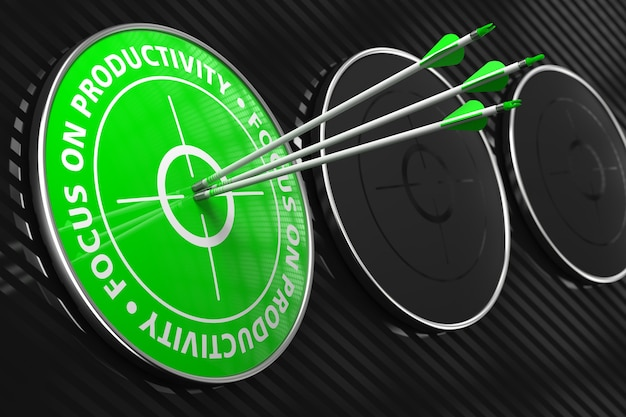 Focus on productivity slogan. three arrows hitting the center of green target on black background.
