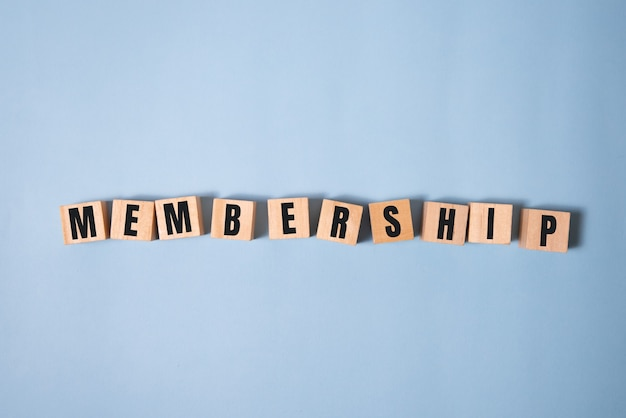 Focus on wooden blocks with letters making membership text. concept image.