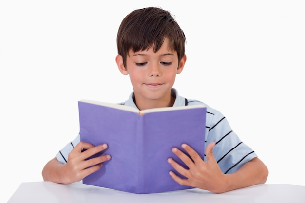 Focused boy reading a book