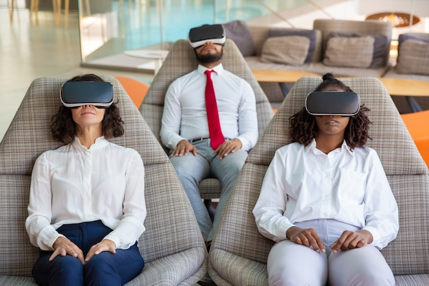 Focused business colleagues in vr headsets