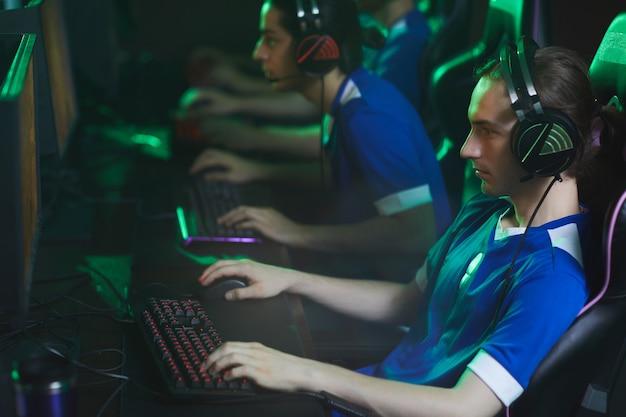 Focused cyber gamer in headset Premium Photo