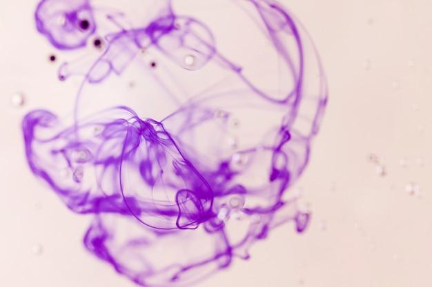 Focused and defocused violet smoke