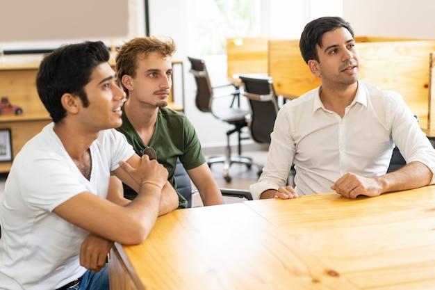 Focused interested employees listening to speaker