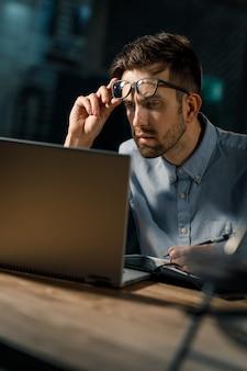 Focused man using laptop in office