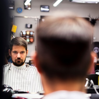 Focused mirror reflection with blurred man
