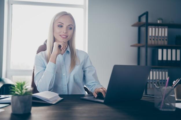 Focused professional girl work netbook