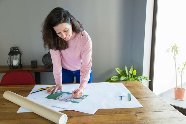 Focused professional working on apartment design project