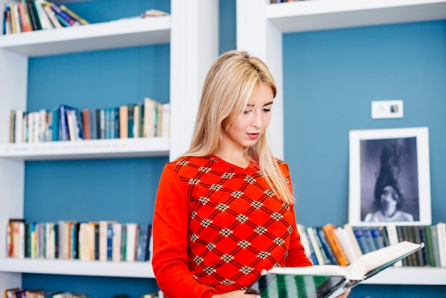 Focused woman reading book