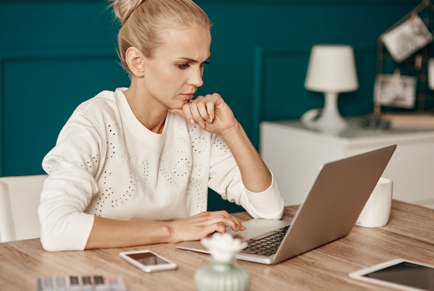 Focused woman working at home