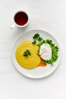Fodmap diet, poached egg benedict with polenta and parmesan cheese