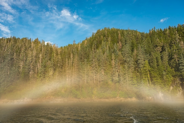 Fogbow or a rainbow in a fog in alaska