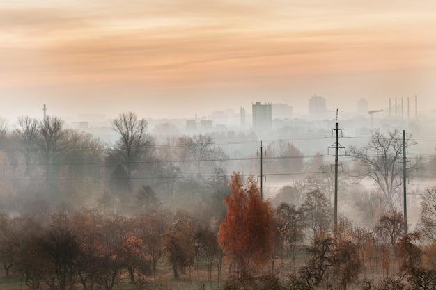 Foggy dawn over the city.