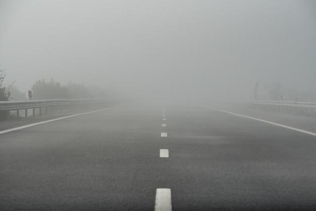Foggy highway empty road