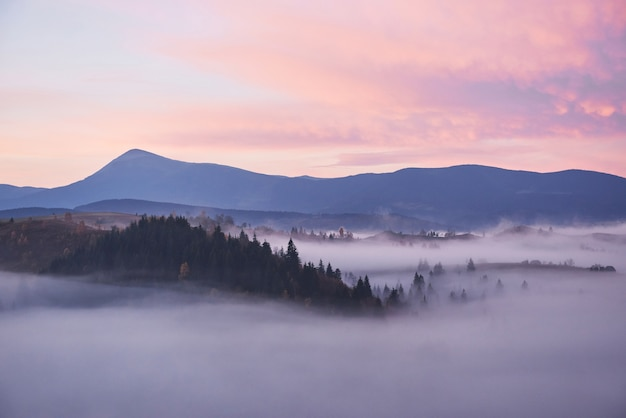 Foggy morning in the ukrainian carpathian mountains in the autumn season.