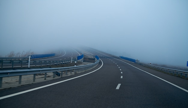 Foggy road with fog in horizon