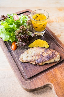 Foie gras steak with vegetable and sweet sauce
