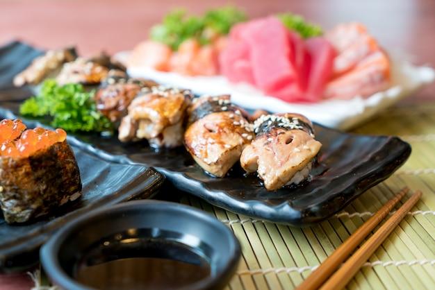 Foie gras sushi set with salmon, tuna, flying fish roe and caviar closeup. japan restauran