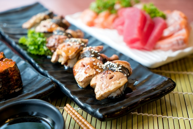 Foie gras sushi set with salmon, tuna, flying fish roe and caviar closeup.