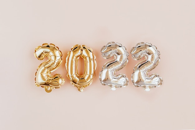 Foil balloons in the form of numbers 2022. new year celebration. gold and silver air balloons. holiday party decoration.