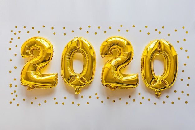 Foil balloons golden color in the form of numbers 2020