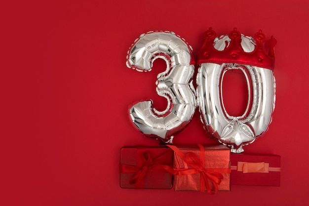 Foil balloons with number  on red background