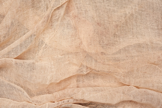 Folded beige cotton gauze kitchen napkin