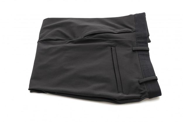 Сложенные черные штаны