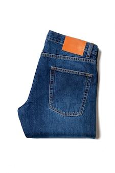 Folded blue jeans isolated on white background